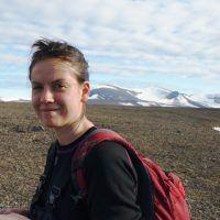 Woman hiking in arctic tundra on Svalbard.