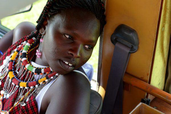 Maasai guide in safari jeep on Basecamp Explorer game drive in Masai Mara.