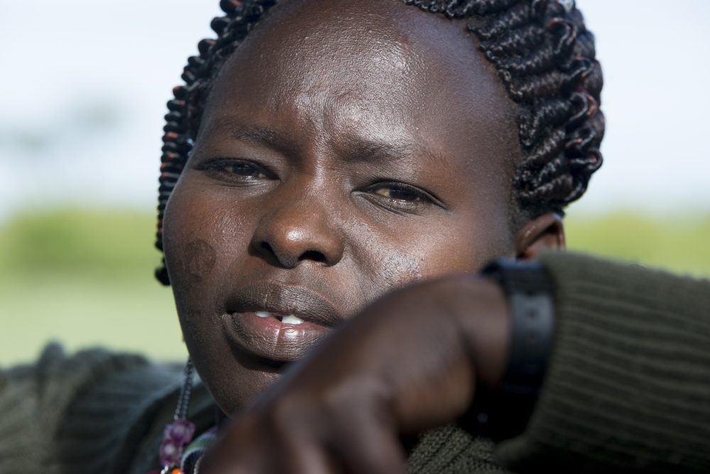 Portrait photo of Maasai guide on game drive in Masai Mara.