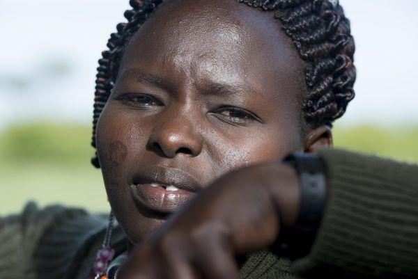 Portrait photo of Maasai guide on game drive in Masai Mara.