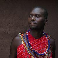 Portrait photo of Maasai man in traditional clothes.