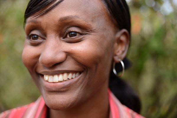 Portrait photo of smiling woman.