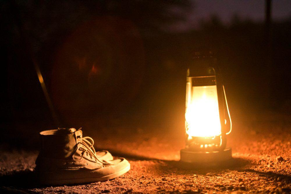 Closeup of shoes and lantern at Wilderness camp in Masai Mara.