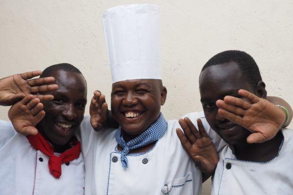 Basecamp Explorer Kenya kitchen staff smiling.