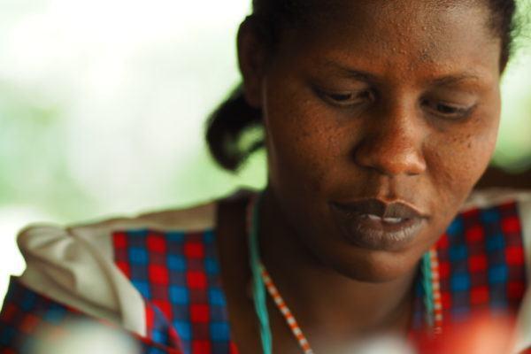 Maasai woman making traditional handicrafts.