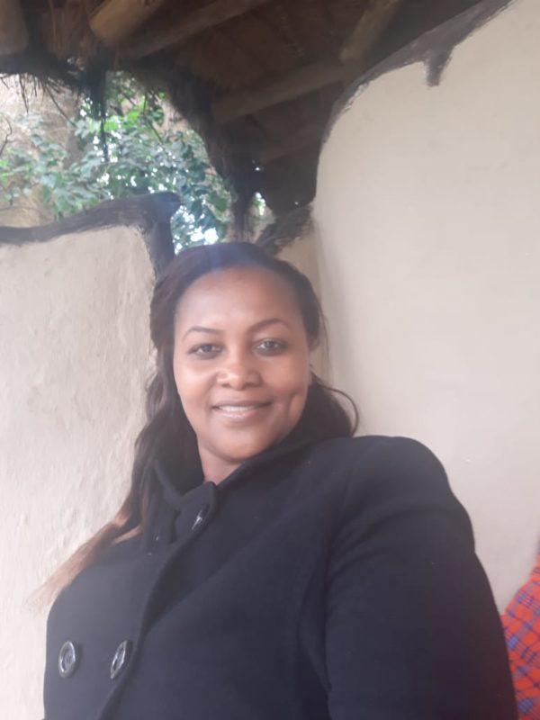 Woman smiling at camera.