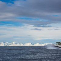 Basecamp Explorer Isfjord Expressen boat driving through arctic waters on Svalbard.